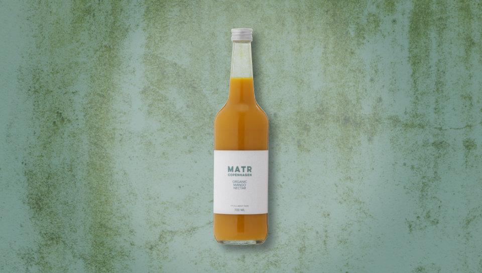 Økologisk mangonektar i glasflaske
